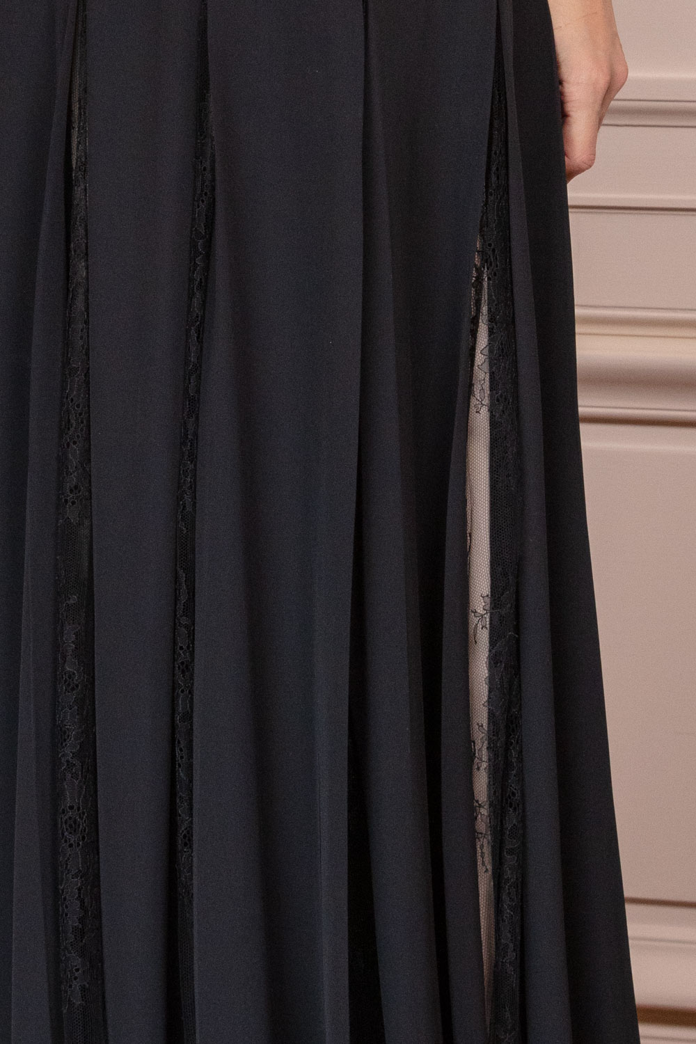 Evening gown in black crepe georgette with twist neck over nude lace underdress
