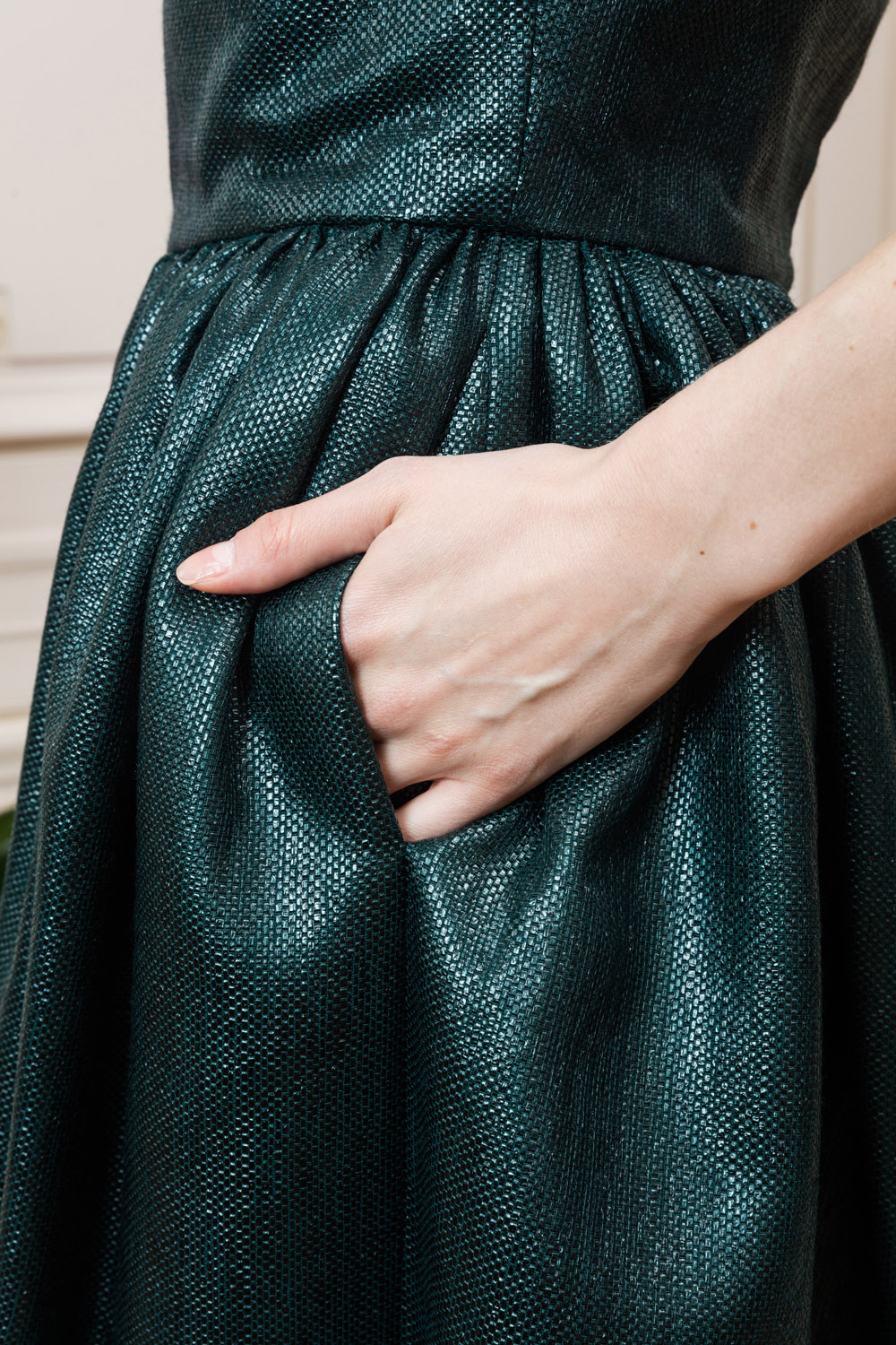 Dark green strapless dress with a flowy skirt