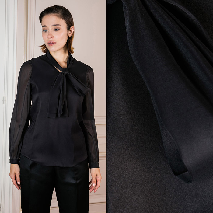 Fitted black shirt with a bow around the neck
