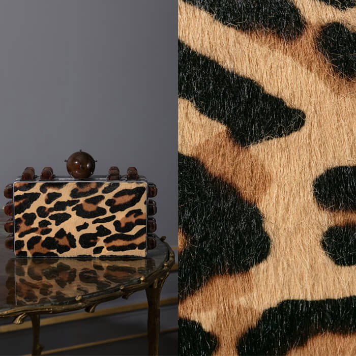 Leopard printed ponyskin and metallic leather clutch bag with Perspex embellishment
