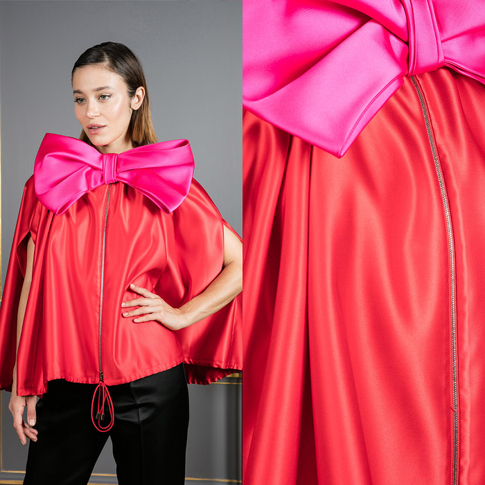 Cape inspired jacket with a large bow