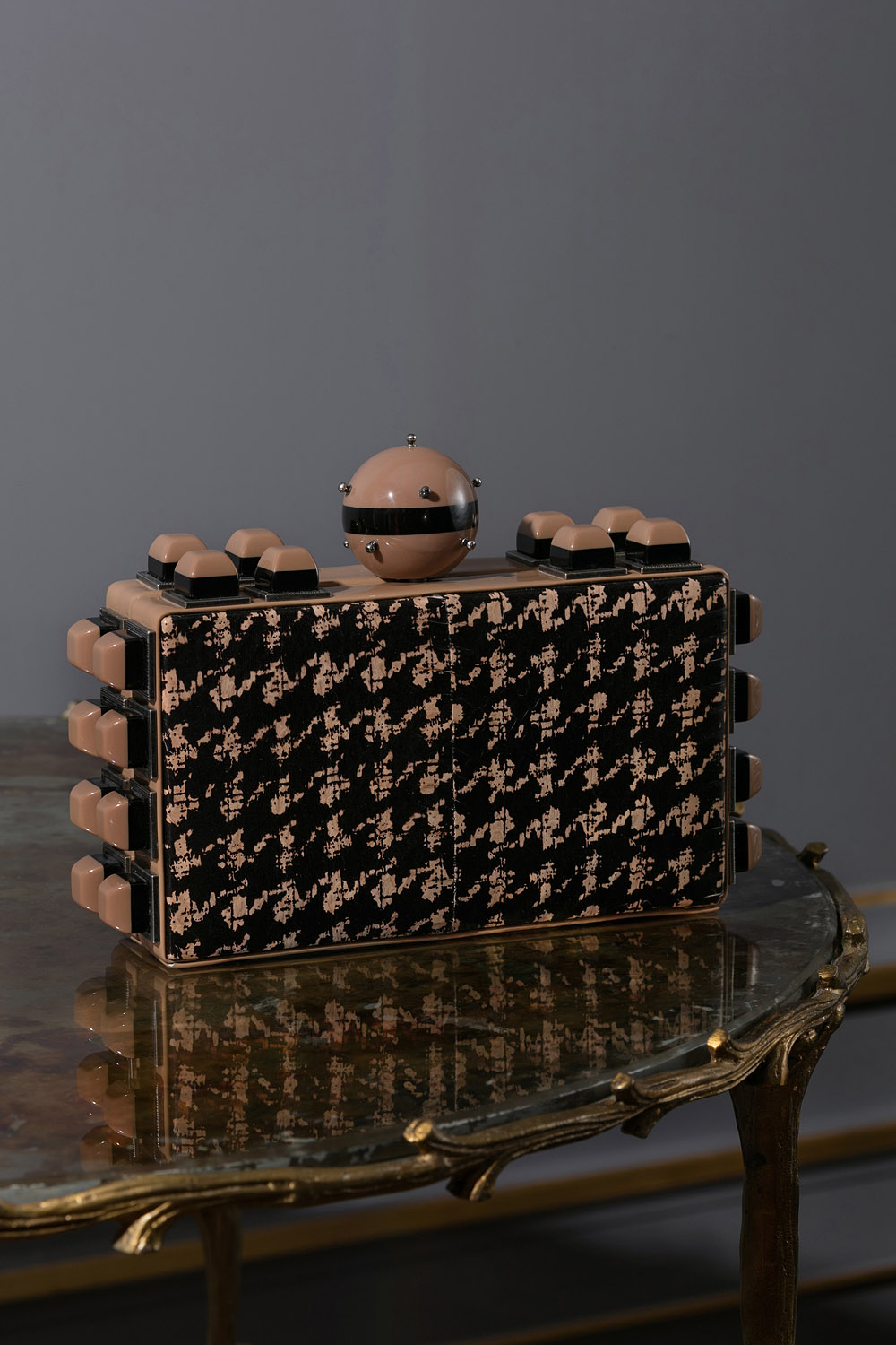 Black leather houndstooth clutch bag with Perspex embellishment