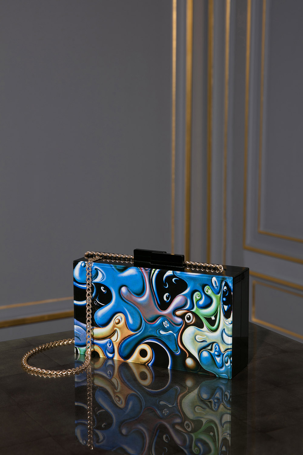 Acrylic clutch printed with art by Kenny Schauf