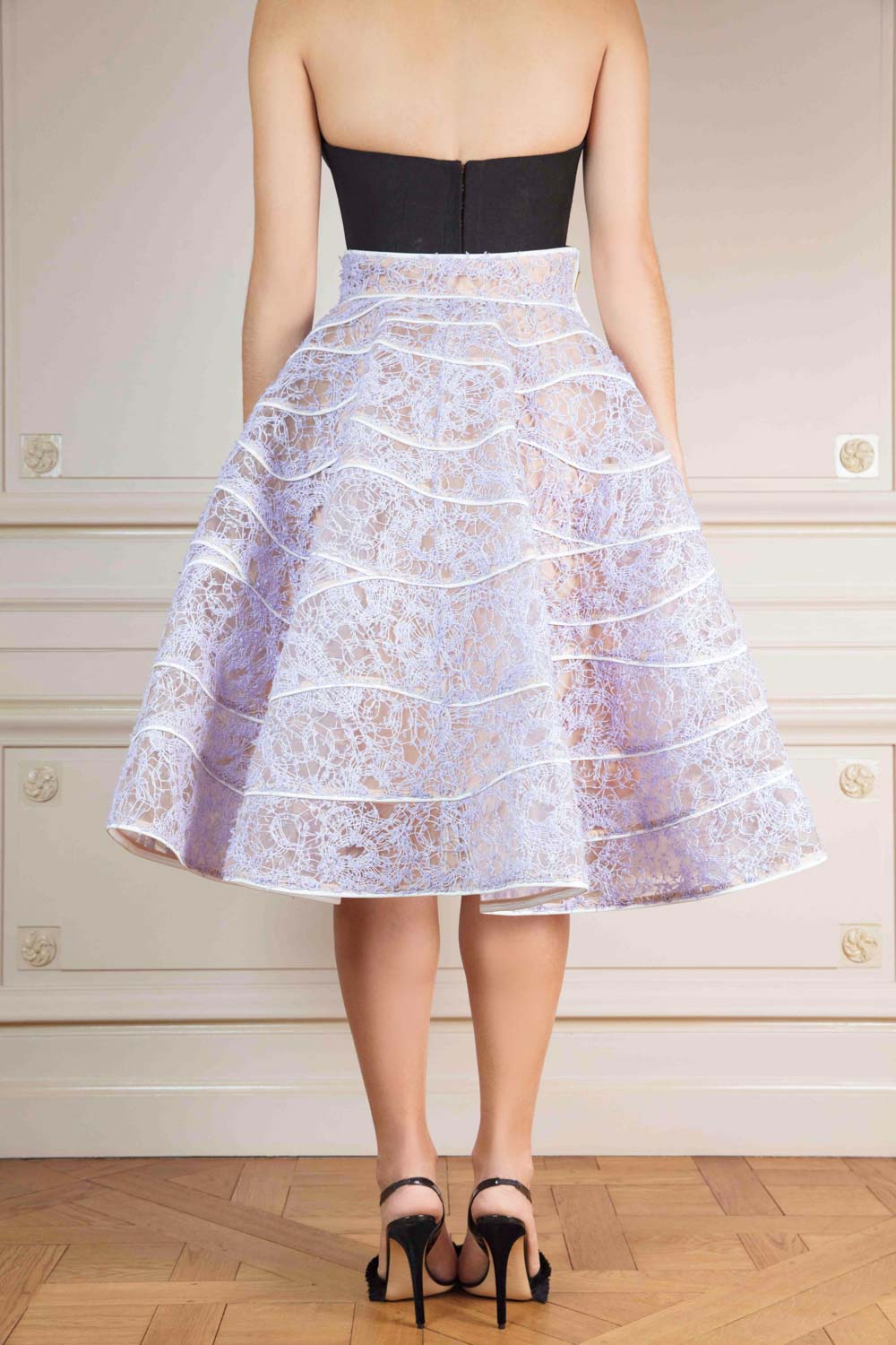 Exclusive white macramé lace midi skirt with leather details