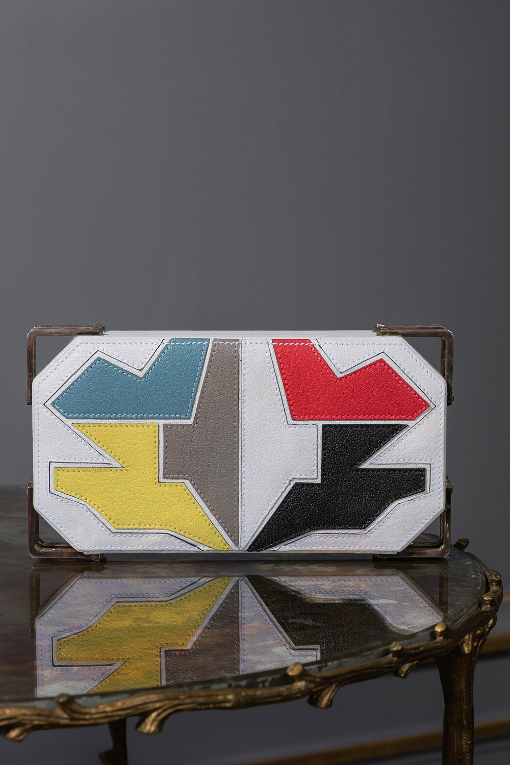 White geometric leather and metal clutch bag